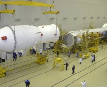 A Proton-M being readied for launch (Credits: RIA Novosti).