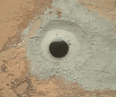 The bore-hole at John Klein, showing the lesser oxidized grey powder (Credits: NASA.)