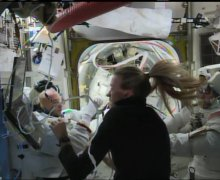 Parmitano helped by the crew to take his helmt off  (Credits:  NASA TV)