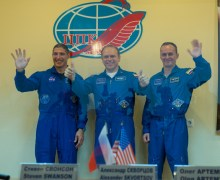 Expedition 37 NASA Flight Engineer Michael Hopkins, far left, Soyuz Commander Oleg Kotov and Russian Flight Engineer Sergey Ryazanskiy, far right, wave and give the thumbs up following a press conference held at the Cosmonaut Hotel, on Tuesday, Sept. 24, 2013, in Baikonur, Kazakhstan. Launch of the Soyuz rocket is scheduled for September 26 and will send Hopkings, Kotov, Ryazanski on a five and a half-month mission aboard the International Space Station. Photo Credit: (NASA/Carla Cioffi)
