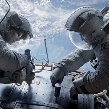 """Gravity"" astronauts Ryan Stone (Sandra Bullock) and Matt Kowalski (George Clooney) repair the Hubble Space Telescope (Credits: Warner Bros.)."