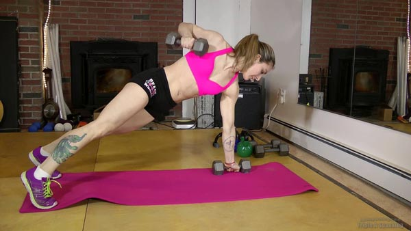 Lily Swan working out in lycra outfit on the yoga mat