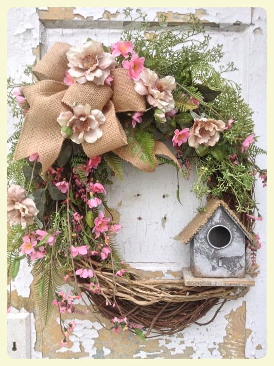 Easter wreath - gorgeous flowers and birdhouse. Featured by LE CHEMIN ABA, learning house for children with autism and other special needs, in Paris, France.
