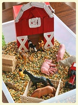 Interactive farm animals sensory box.