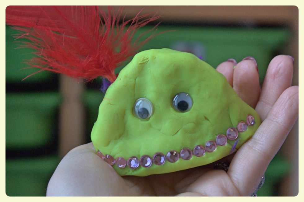 Yellow playdough monster with feather. Featured by Special Learning House. www.speciallearninghouse.com..jpg
