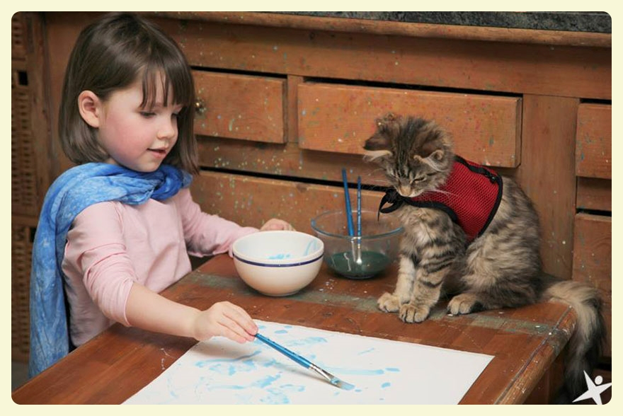 Iris Grace & Thula her therapy cat. The special bond between animals and autistic children. Featured by Special Learning House. www.speciallearninghouse.com.jpg
