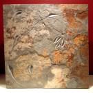 Floral design carved slate wall plaque