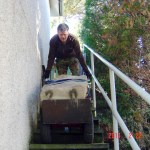 Delivering a sculpture down garden steps