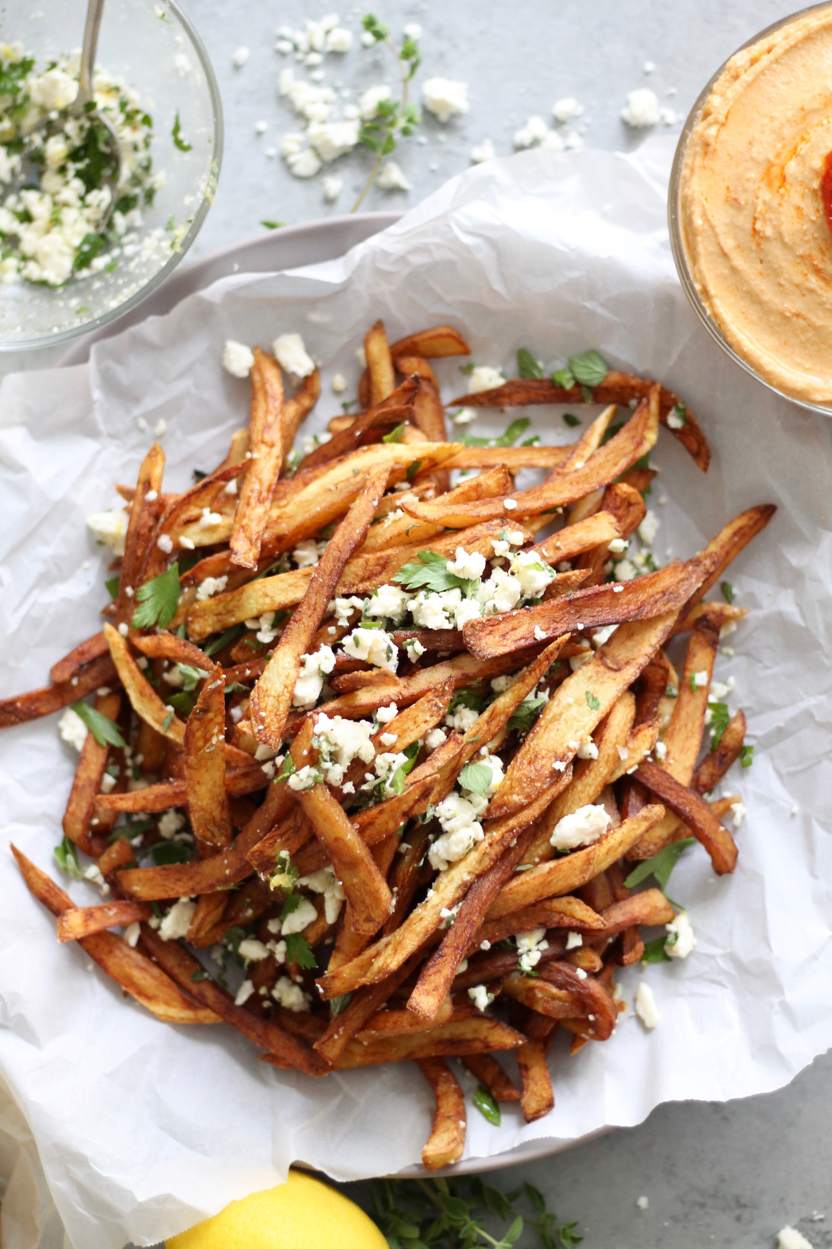 Feta, Herb  Lemon Garlic Fries with Spicy Harissa HummusSpices
