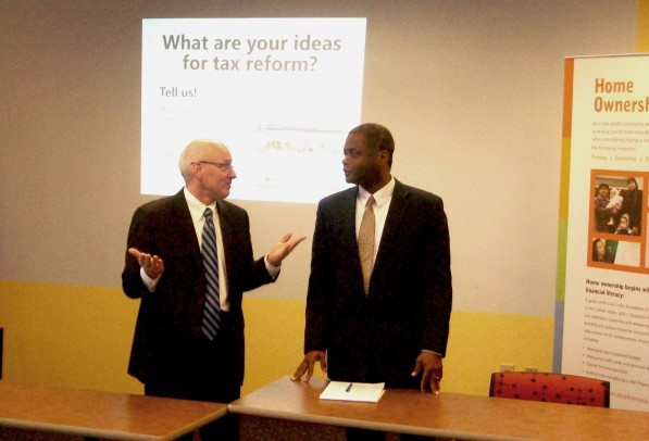 l-r: Revenue Commissioner Myron Frans and Human Rights Commissioner Kevin Lindsay discuss tax reform with<br /><br /> local business owners of color.<br /><br /> Photo by Charles Hallman<br /><br />