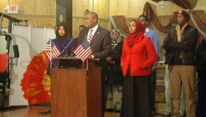 Hussein Samatar stands with Somali high school students.