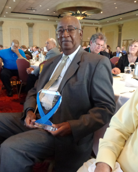 John Washington with award Photos by Charles Hallman
