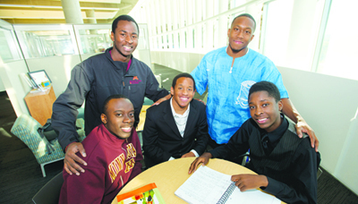 [Standing l-r] Allan Kerandi, peer mentor; Profit Idowu, community advisor. [Seated from l-r] Huntley House participants Eric Dormoh, Kohlman Thompson and Barflaan Tedoe  Photo courtesy of the University of Minnesota