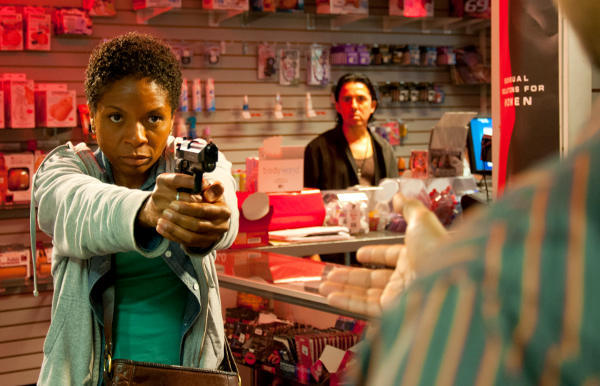Bernice (LisaGay Hamilton) takes drastic action in a scene from John Sayles' GO FOR SISTERS. (Photo by Kevin J. Long)