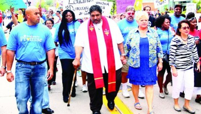 "Rev. Dr. William Barber (center) led a ""March for Equity"" in downtown Minneapolis on Saturday, August 16.  Photo by Travis Lee"