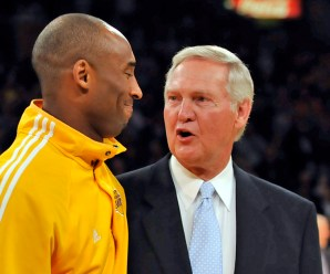 Lakers guard Kobe Bryant, left, receives a basketball from Jerry West to commemorate Bryant breaking West's record as the all-time leading scorer for the Lakers before their game against the Charlotte Bobcats on Wednesday night.  ///ADITIONALINFO - lakers.0204 -  02/03/`10 - Photo by Rose Palmisano - The Orange County Register - The Lakers take on the Charlotte Bobcats at Staple Center.