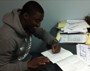 USF cornerback Kayvon Webster signing his Standard Representation Agreement with MAC.