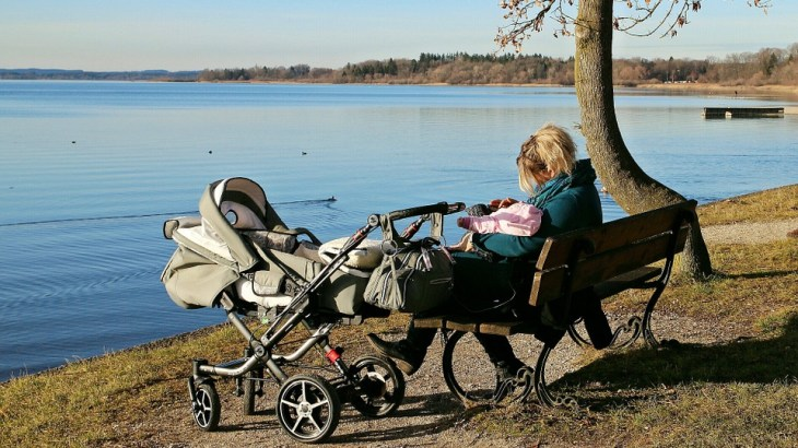 woman and baby stroller