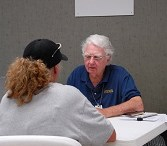 Savannah, MO 6-29-07 Peggy Schweder talks with FEMA IA SpecialistGervasse Johnson in a Disaster Recovery Center (DRC).   DRC's provide applicants with information and help with their FEMA applications.  Marvin Nauman/FEMA photo