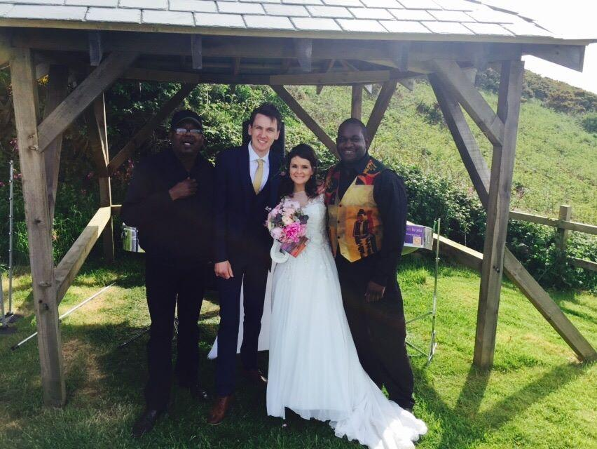 Steelasophical wedding steel band with bride and groom posing photoshoot wedding photography Ocean kave