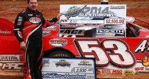 Ray Cook of Brasstown, NC celebrates his win on Friday afternoon in the Super Bowl of Racing Presented By Rock Auto.com 2014 season opener for the NeSmith Chevrolet Dirt Late Model Series at Golden Isles Speedway in Brunswick, GA.  (Heath Lawson Photo)