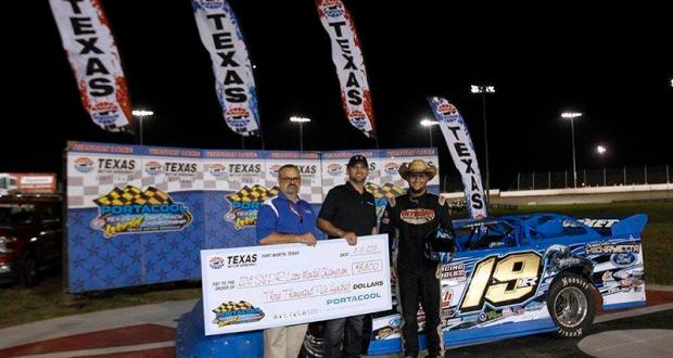 FORT WORTH, TX - MAY 16:   Ryan Gustin, driver of the #19 SUPR Late Model division, poses with the winners check along with Texas Motor Speedway track announcer Rich Phillips after winning  the SUPR Late Model Championship at the Portacool Texas World Dirt Track Championship at Texas Motor Speedway on May 16, 2015 in Fort Worth, Texas.  (Photo by Mike Stone/Getty Images for Texas Motor Speedway)