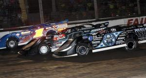 Scott Bloomquist battles Eric Wells & Josh Richards - Jim Denhamer photo
