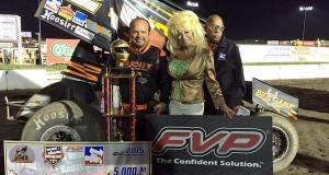 "Danny Lasoski poses in Victory Lane with ""Sandy is Dolly"" and flagman Doug Clark Thursday at I-80 Speedway"