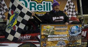 "Dennis ""Rambo"" Franklin of Gaffney, SC holds the $10,000 check after winning the 100-lap 11th Annual World Championship Race for the NeSmith Chevrolet Dirt Late Model Series driving the M&W Transportation Special on Saturday night at Bubba Raceway Park in Ocala, FL.  Franklin had been trying for ten years to win the race, only to have something go wrong while leading.  The driver known as Rambo made a statement by leading 75 of the 100 laps and lapping all but the second and third-place cars.  He even held off a hard-charging Kyle Bronson of Brandon, FL in the last 11 laps of the race, after Bronson made a strategic move that should have left Franklin a sitting duck.  (NeSmith Media Photo by Bruce Carroll)"