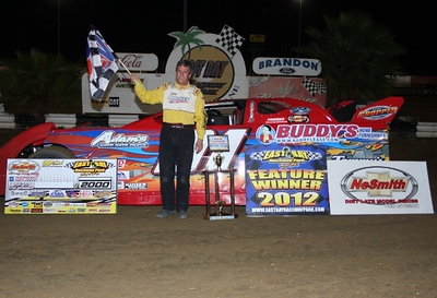 Jack Nosbisch Jr. of Riverview, FL celebrates his Thursday night victory in the NeSmith Chevrolet Dirt Late Model Series season opener at East Bay Raceway Park driving the Buddy's Home Furnishings Rocket.  (East Bay Raceway Park Photo)