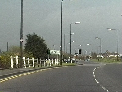 The original railings from the Holiday Camp on Dymchurch Road, 1999. The turning into Jefferstone Lane can be seen just beyond the traffic lights.