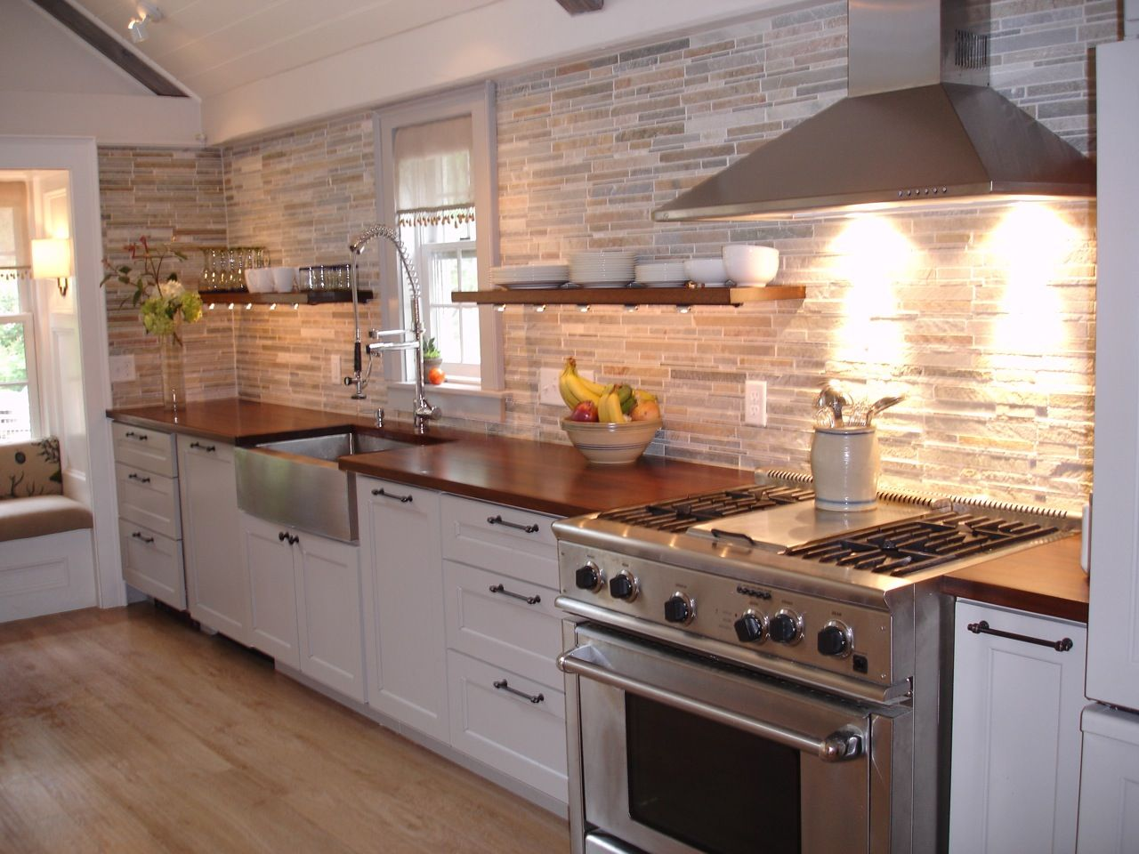 how to choose a wood countertop for your kitchen wooden kitchen countertops Mahogany wood countertop provides a warm contrast to stainless steel and white shaker kitchen cabinets