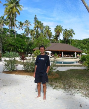 Adriano in front of a small resort on the Isle of Pines