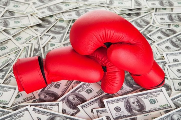 18461930 - boxing gloves on top of 100 dollars bills