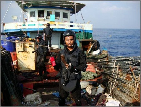 Personnel from INS Tir, having boarded the Prantalay 11.