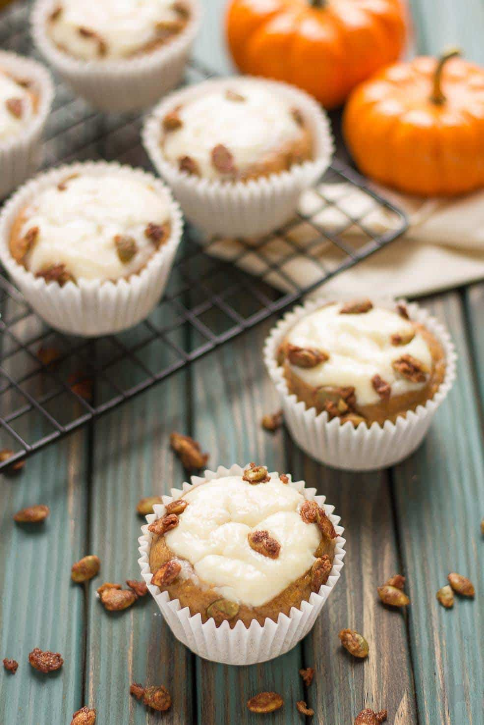 Pumpkin Spice Cream Cheese Muffins are the quintessential treat of Fall. Filled with aromatic autumn spices, stuffed with cream cheese and sprinkled with sugared pepitas, this is sure to be your go to Pumpkin Spice Cream Cheese Muffins recipe. | Strawberry Blondie Kitchen