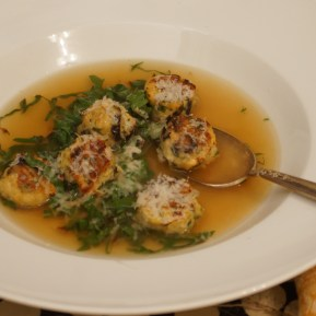 Chicken & Black Olive Meatballs in Consomme with Swiss Chard