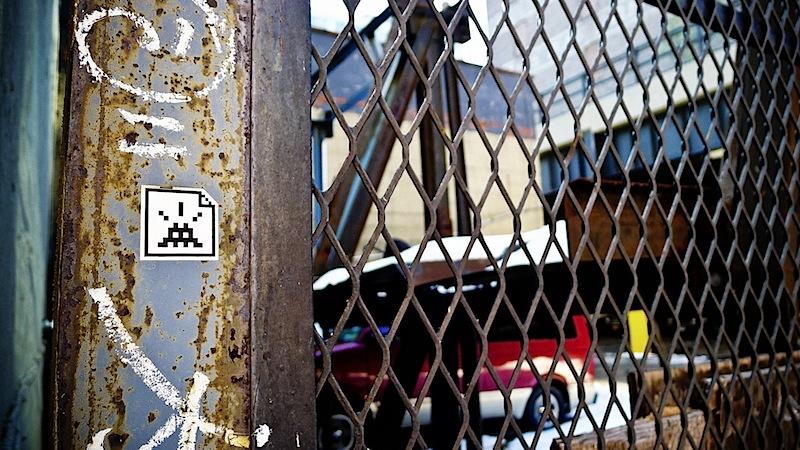 space_invader_sticker_in_nyc.jpg
