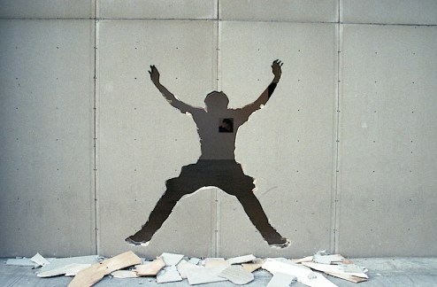 a cut out of a man jumping at the entrance of a gallery in chelsea, nyc