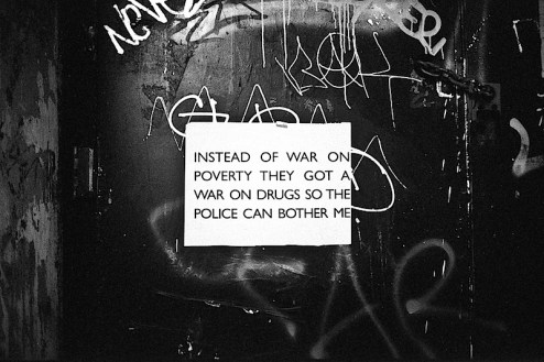 instead of a war on poverty they have a war on drugs so the police can bother me graffiti in the lower east side of NYC