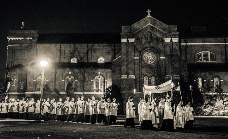 The procession started off past the Chapel of St. Thomas Aquinas and across the upper quad.