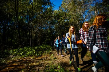 Students walk through Hidden Falls Park.