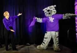 President Julie Sullivan and Tommie debut a new t-shirt at the event.