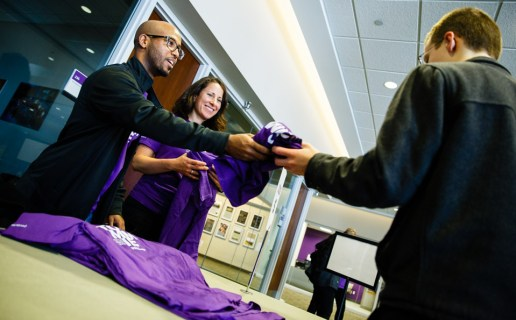 Students pick up t-shirts following the brand launch event.