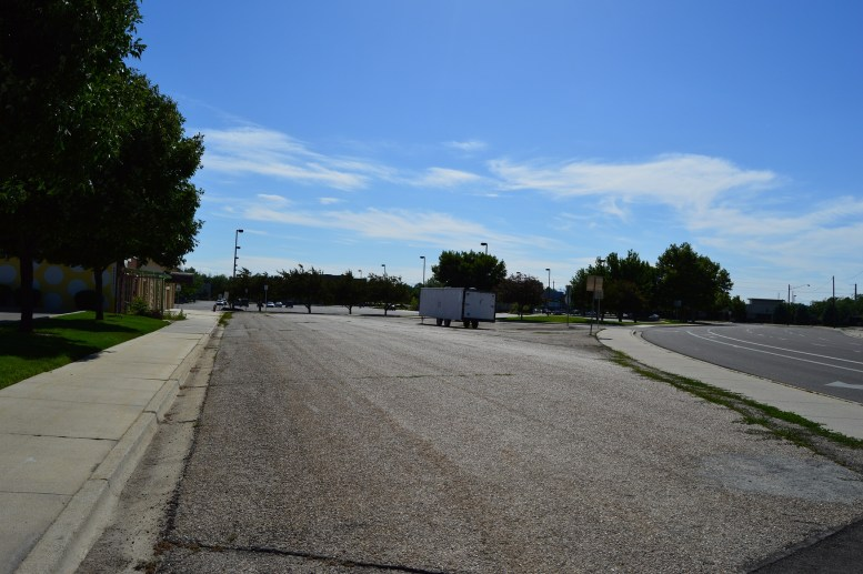Former residents recall playing in a gravel pit that used to occupy the location of this parking lot