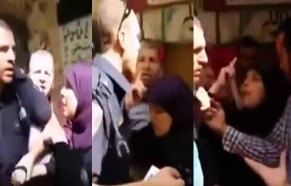بالفيديو: امرأة شجاعة تمنع شرطياً إسرائيلياً من القبض على فتاة فلسطينية