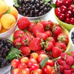 Different berries in bowls.
