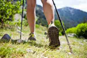 Woman hiking in mountains, adventure and exercising