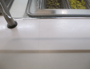 Before - Wentworth Cafeteria: Seam Separation  on the Grill Station