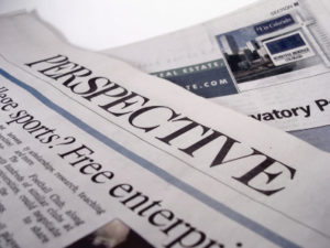 Perspective newspaper on a Holy in the Daily blog post